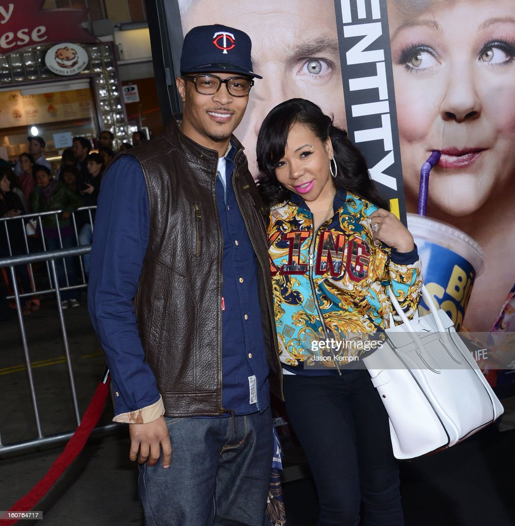 T.I. and Tameka 'Tiny' Cottle attend the premiere Of Universal Pictures' 'Identity Thief' on February 4, 2013 in Westwood, California.