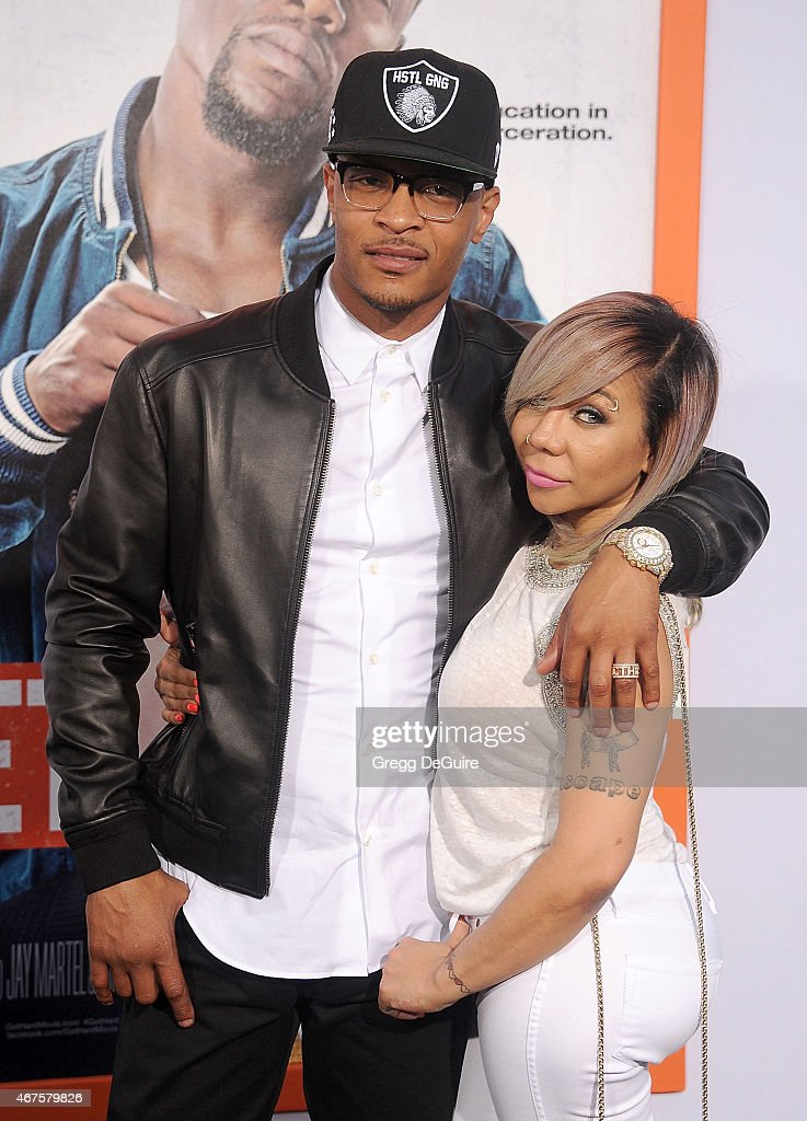 T.I. and Tameka 'Tiny' Cottle-Harris arrive at the Los Angeles premiere of 'Get Hard' at TCL Chinese Theatre IMAX on March 25, 2015 in Hollywood, California.