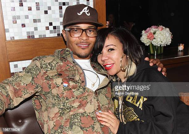 TI and Tameka Tiny CottleHarris attend Moet Rose Lounge presents TI a celebration for his new album Trouble Man Heavy is The Head at Baoli on...