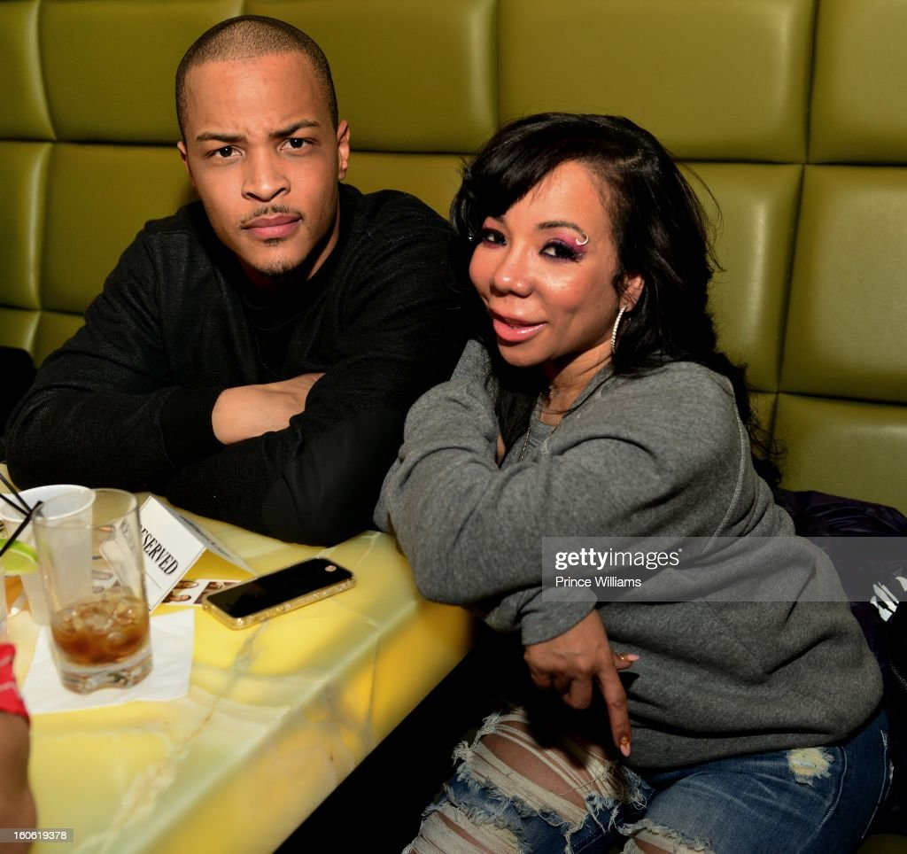 <a gi-track='captionPersonalityLinkClicked' href=/galleries/search?phrase=T.I.&family=editorial&specificpeople=221599 ng-click='$event.stopPropagation()'>T.I.</a> and Tameka 'Tiny' Harris attend a birthday party for <a gi-track='captionPersonalityLinkClicked' href=/galleries/search?phrase=T.I.&family=editorial&specificpeople=221599 ng-click='$event.stopPropagation()'>T.I.</a>'s son Messiah at Buckhead Bottlebar on February 2, 2013 in Atlanta, Georgia.