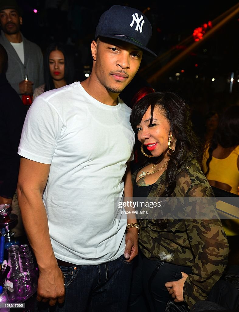 <a gi-track='captionPersonalityLinkClicked' href=/galleries/search?phrase=T.I.&family=editorial&specificpeople=221599 ng-click='$event.stopPropagation()'>T.I.</a> and Tameka 'Tiny' Harris attend the <a gi-track='captionPersonalityLinkClicked' href=/galleries/search?phrase=T.I.&family=editorial&specificpeople=221599 ng-click='$event.stopPropagation()'>T.I.</a> Welcome To Atlanta Party for Big Tigger at Reign Nightclub on January 1, 2013 in Atlanta, Georgia.