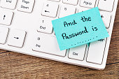 And the password is text on sticky note. with white computer keyboard.