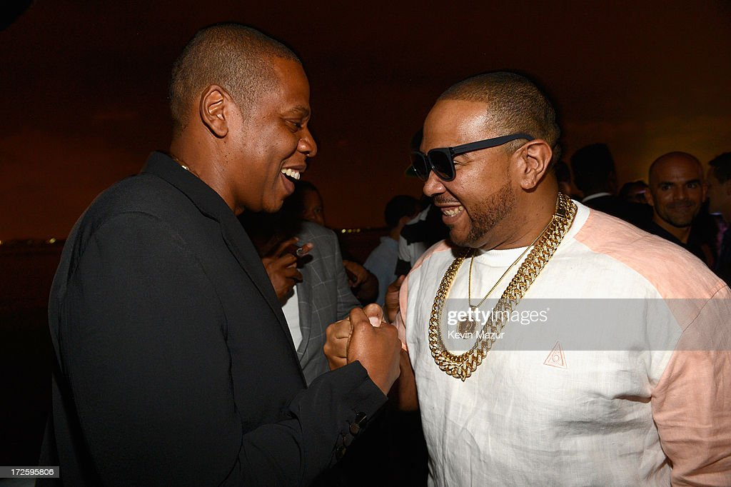 JAY Z and <a gi-track='captionPersonalityLinkClicked' href=/galleries/search?phrase=Timbaland+-+Rapper&family=editorial&specificpeople=546742 ng-click='$event.stopPropagation()'>Timbaland</a> attend JAY Z and Samsung Mobile's celebration of the Magna Carta Holy Grail album, available now through a customized app in Google Play and Samsung Apps exclusively for Samsung Galaxy S 4, Galaxy S III and Note II users on July 3, 2013 in Brooklyn City.