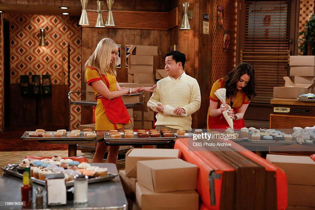 'And Too Little Sleep' The diner gang helps Max and Caroline bake throughout the night in order to fulfill a gigantic cupcake order, on 2 BROKE GIRLS, Monday, Jan 21 (9:00-9:30 PM, ET/PT) on the CBS Television Network. Left to Right: Caroline Channing (Beth Behrs), Han Lee (Matthew Moy), Max Black (Kat Dennings).