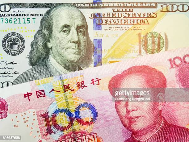 RMB and US dollar bank notes concept business background. Close up view of US Dollar and Chinese yuan bills. currency exchange rate. Background with money american dollar and Chinese yuan banknote
