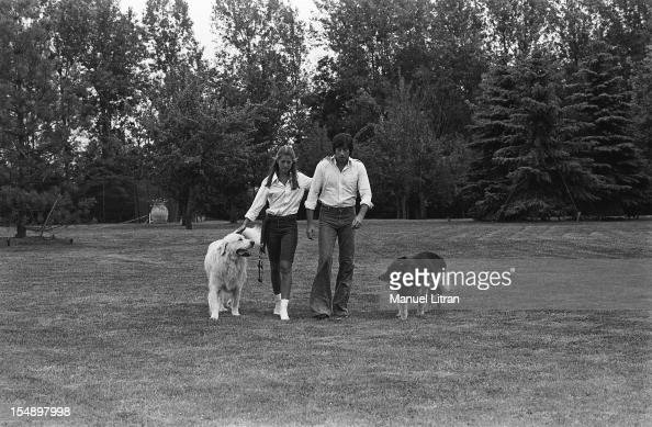 RINGO and walking in the park their home with their dogs FEUCHEROLLES If shepherd of the Pyrenees and German Shepherd Tom