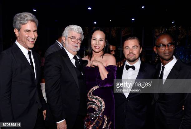LACMA CEO and Wallis Annenberg Director Michael Govan wearing Gucci honoree George Lucas Art Film Gala CoChair Eva Chow wearing Gucci Art Film Gala...
