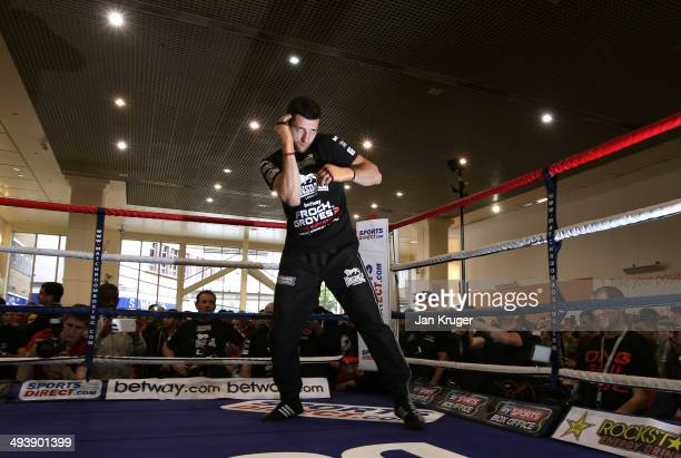 IBF and WBA supermiddleweight champion Carl Froch works out at Broadmarsh Shopping Centre on May 26 2014 in Nottingham England
