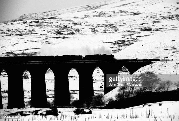 BLACK and WHITE The Winter Cumbrian Mountain Express the first of 2013 crosses the viaduct across the valley of the River Ribble at Ribblehead in...