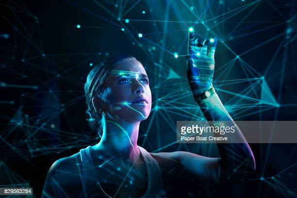 And young woman decoding a virtual puzzle through a complex hologram flashed in front of her