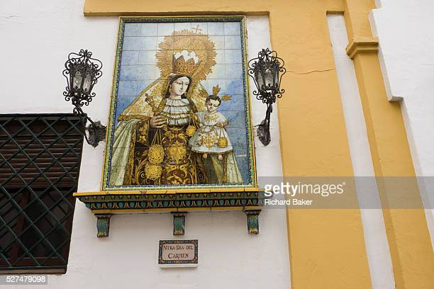 Andalucian ceramic tiling of the Virgin Mary and baby Jesus on the wall of the Basilica de la Macarena in Seville Inside the church the Basilica de...
