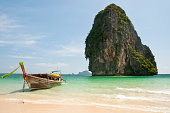 Long tail boat and limestone rock in the Andaman Sea - Krabi - Thailand