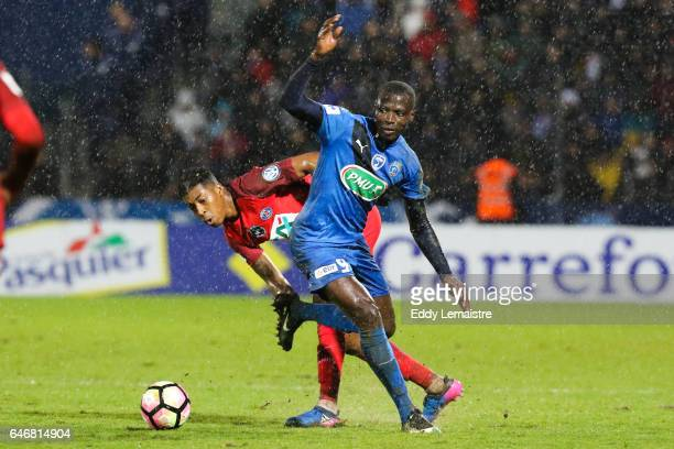 Ande Dona Ndoh of Niort and Presnel Kimpembe of PSG during the French Cup match between Niort and Paris Saint Germain on March 1 2017 in Niort France