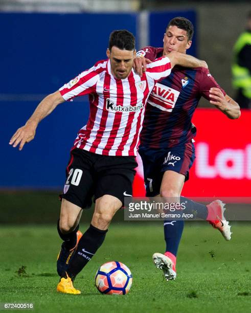 Ander Capa of SD Eibar duels for the ball with Aritz Aduriz of Athletic Club during the La Liga match between SD Eibar and Athletic Club at Ipurua...