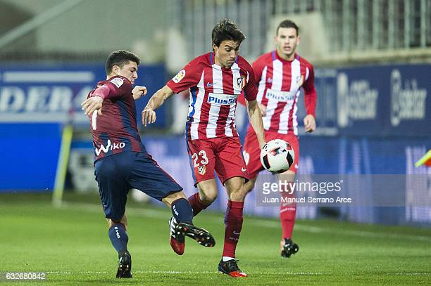 Ander Capa of SD Eibar duels for the ball with Niko Gaitan of Atletico Madrid during the Copa del Rey Quarter Final 2nd Leg match between SD Eibar...