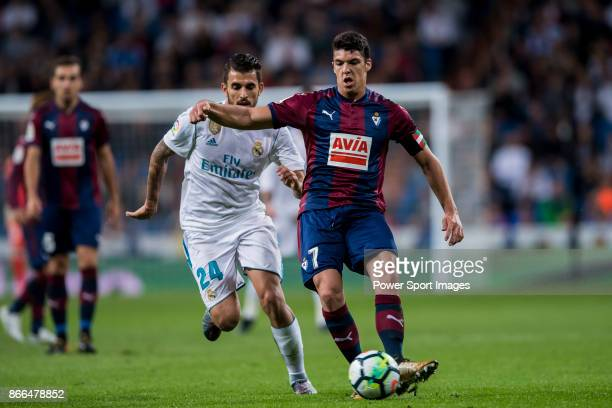 Ander Capa Rodriguez of SD Eibar fights for the ball with Daniel Ceballos Fernandez D Ceballos of Real Madrid during the La Liga 201718 match between...