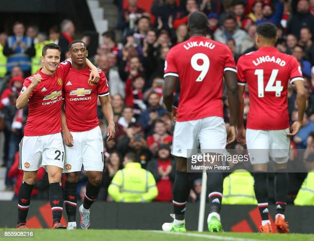 Ander Herrera and Anthony Martial of Manchester United celebrate Romelu Lukaku scoring their fourth goal during the Premier League match between...