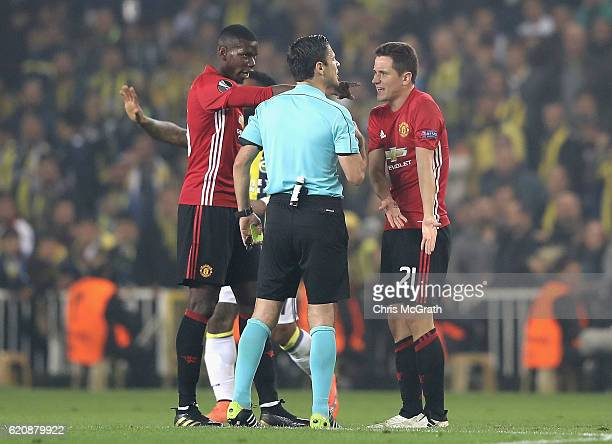 Ander Herrera and Paul Pogba of Manchester United speak to the referee during the UEFA Europa League Group A match between Fenerbahce SK and...