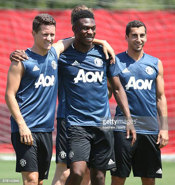 Ander Herrera and Timothy FosuMensah of Manchester United in action during a first team training session as part of their preseason tour of China at...