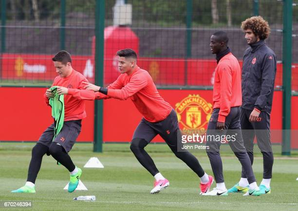 Ander Herrera Marcos Rojo Eric Bailly and Marouane Fellaini of Manchester United in action during a first team training session at Aon Training...