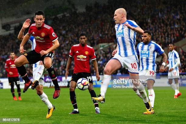 Ander Herrera of Manchester United and Aaron Mooy of Huddersfield Town in action during the Premier League match between Huddersfield Town and...