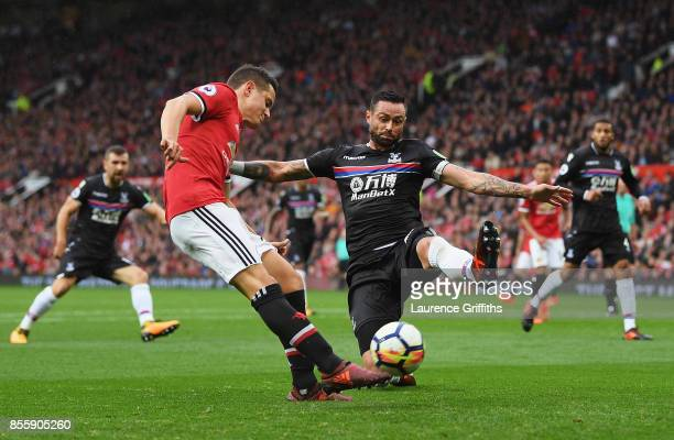 Ander Herrera of Manchester United and Damien Delaney of Crystal Palace compete for the ball during the Premier League match between Manchester...
