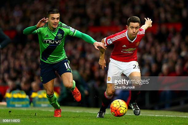 Ander Herrera of Manchester United and Dusan Tadic of Southampton compete for the ball during the Barclays Premier League match between Manchester...