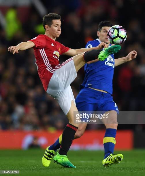 Ander Herrera of Manchester United and Gareth Barry of Everton battle for possession during the Premier League match between Manchester United and...