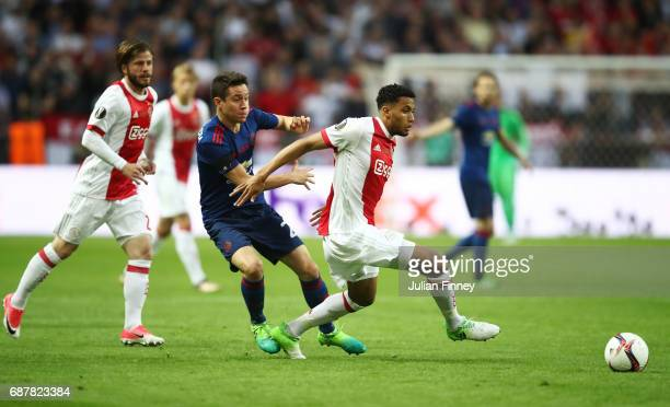 Ander Herrera of Manchester United and Jairo Riedewald of Ajax battle for possession during the UEFA Europa League Final between Ajax and Manchester...