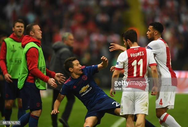Ander Herrera of Manchester United and Jairo Riedewald of Ajax confront each other during the UEFA Europa League Final between Ajax and Manchester...