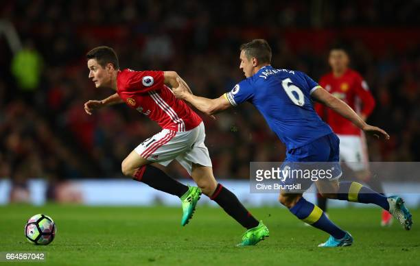 Ander Herrera of Manchester United attempts to get past Phil Jagielka of Everton during the Premier League match between Manchester United and...