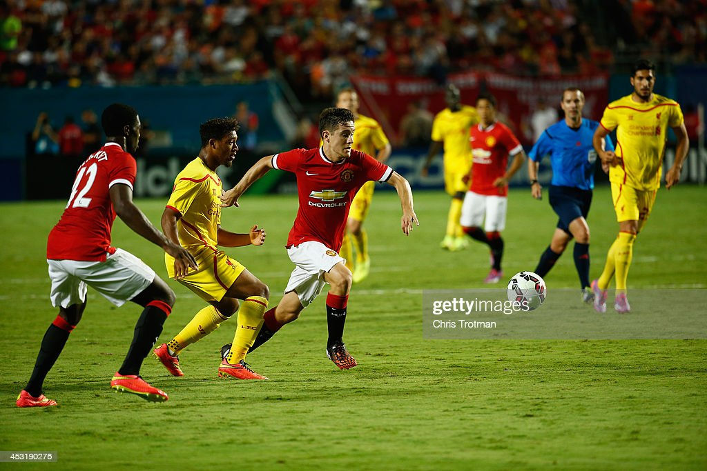 <a gi-track='captionPersonalityLinkClicked' href=/galleries/search?phrase=Ander+Herrera&family=editorial&specificpeople=6331880 ng-click='$event.stopPropagation()'>Ander Herrera</a> #21 of Manchester United battles for the ball against Liverpool in the Guinness International Champions Cup 2014 Final at Sun Life Stadium on August 4, 2014 in Miami Gardens, Florida.