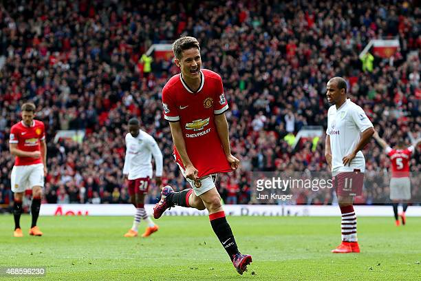 Ander Herrera of Manchester United celebrates after scoring the opening goal during the Barclays Premier League match between Manchester United and...