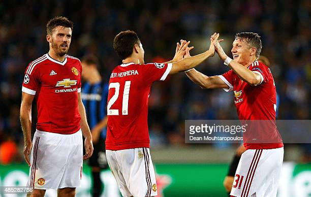 Ander Herrera of Manchester United celebrates scoring his team's fourth goal with Bastian Schweinsteiger of Manchester United during the UEFA...