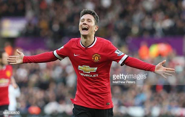 Ander Herrera of Manchester United celebrates scoring their first goal during the Barclays Premier League match between Swansea City and Manchester...