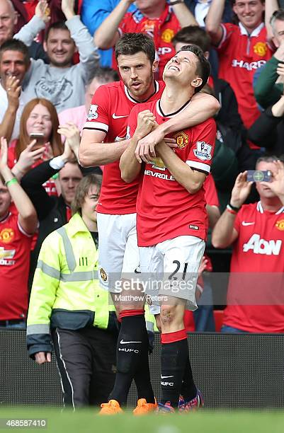 Ander Herrera of Manchester United celebrates scoring their first goal during the Barclays Premier League match between Manchester United and Aston...