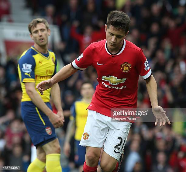 Ander Herrera of Manchester United celebrates scoring their first goal during the Barclays Premier League match between Manchester United and Arsenal...