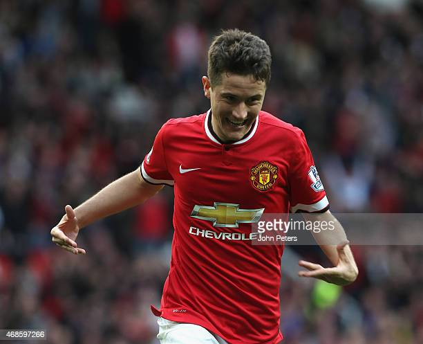 Ander Herrera of Manchester United celebrates scoring their third goal during the Barclays Premier League match between Manchester United and Aston...