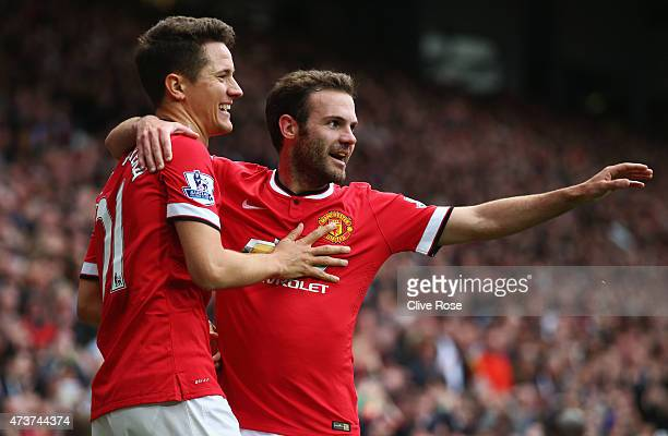 Ander Herrera of Manchester United celebrates with Juan Mata as he scores their first goal during the Barclays Premier League match between...
