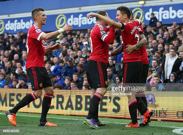 Ander Herrera of Manchester United celebrates with team mates as fetr scoring his team's second goal during the Barclays Premier League match between...