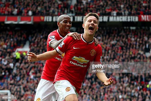 Ander Herrera of Manchester United celebrates with teammate Ashley Young of Manchester United after scoring the opening goal during the Barclays...