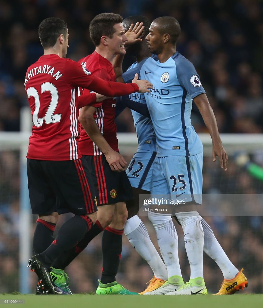 Ander Herrera of Manchester United clashes with Fernandinho of Manchester City during the Premier League match between Manchester City and Manchester United at Etihad Stadium on April 27, 2017 in Manchester, England.