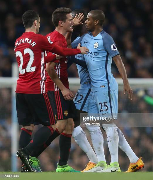 Ander Herrera of Manchester United clashes with Fernandinho of Manchester City during the Premier League match between Manchester City and Manchester...