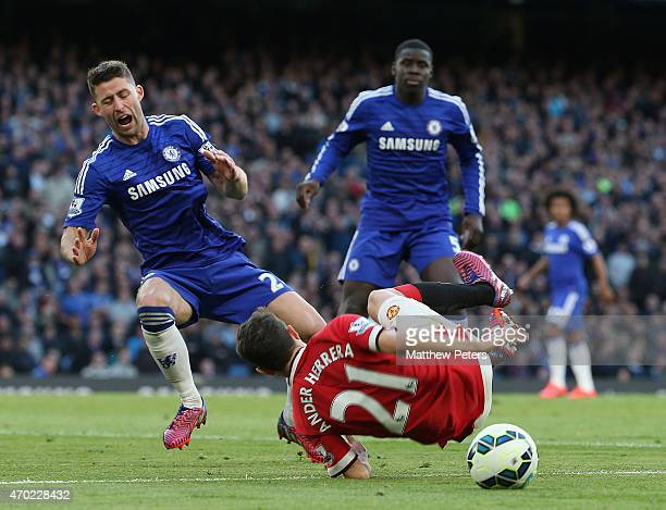 Ander Herrera of Manchester United clashes with Gary Cahill of Chelsea but no penalty is given during the Barclays Premier League match between...