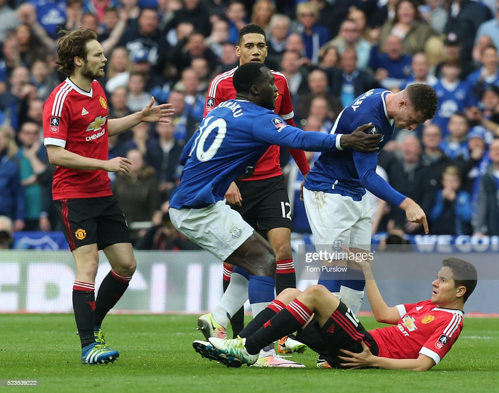 Ander Herrera of Manchester United clashes with Ross Barkley of Everton during the Emirates FA Cup Semi Final match between Manchester United and Everton at Wembley Stadium on April 23, 2016 in London, England.