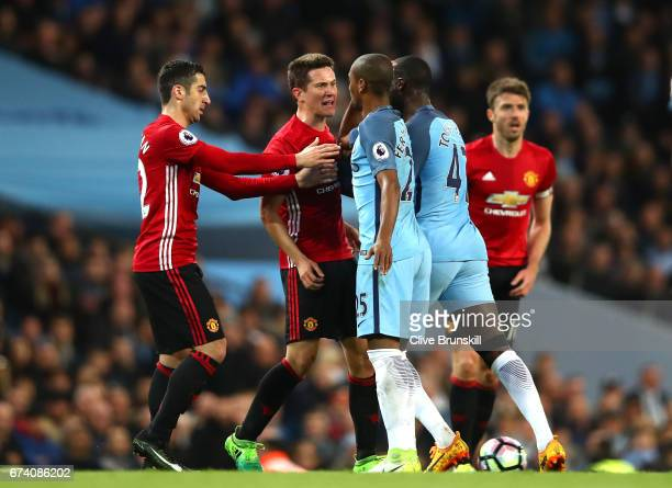 Ander Herrera of Manchester United clashes wuth Fernandinho of Manchester City and Yaya Toure of Manchester City during the Premier League match...