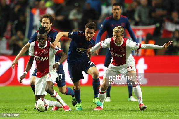 Ander Herrera of Manchester United competes with Frenkie De Jong and Bertrand Traore of Ajax during the UEFA Europa League Final between Ajax and...