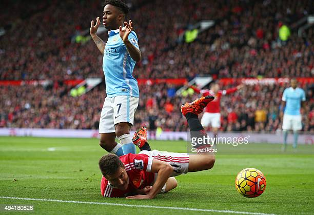 Ander Herrera of Manchester United falls while Raheem Sterling of Manchester City appeals not to bring down during the Barclays Premier League match...