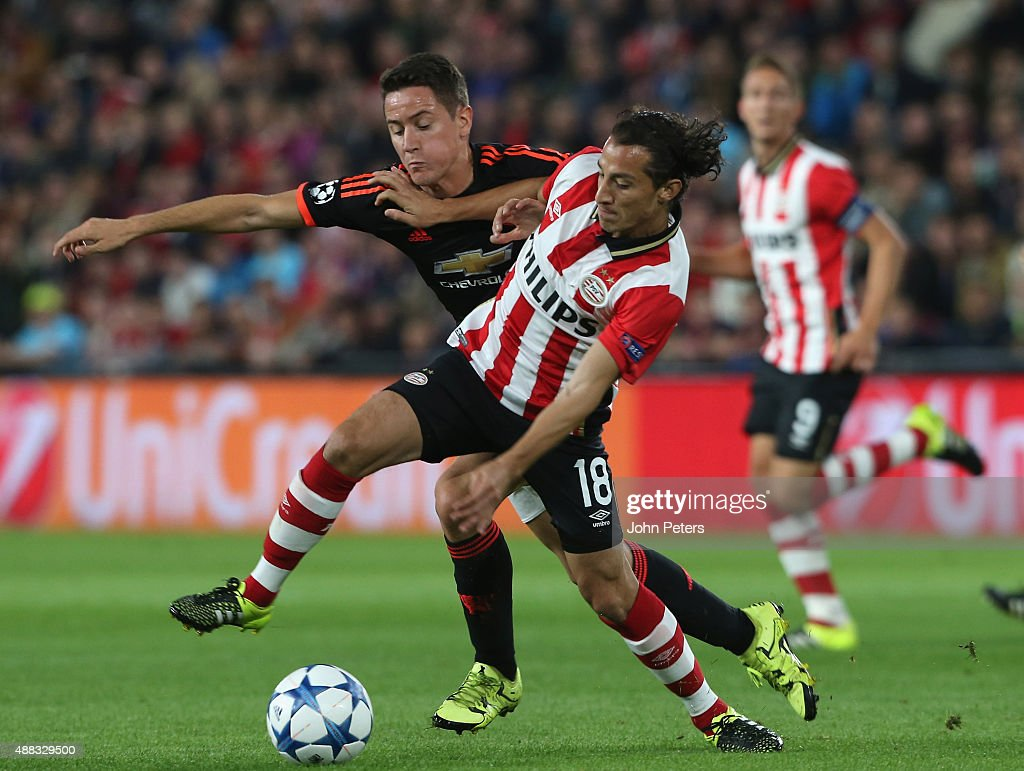 Ander Herrera of Manchester United in action with Andres Guardado of PSV Eindhoven during the UEFA Champions League match between PSV Eindhoven and Manchester United at Philips Stadion on September 15, 2015 in Eindhoven, Netherlands.