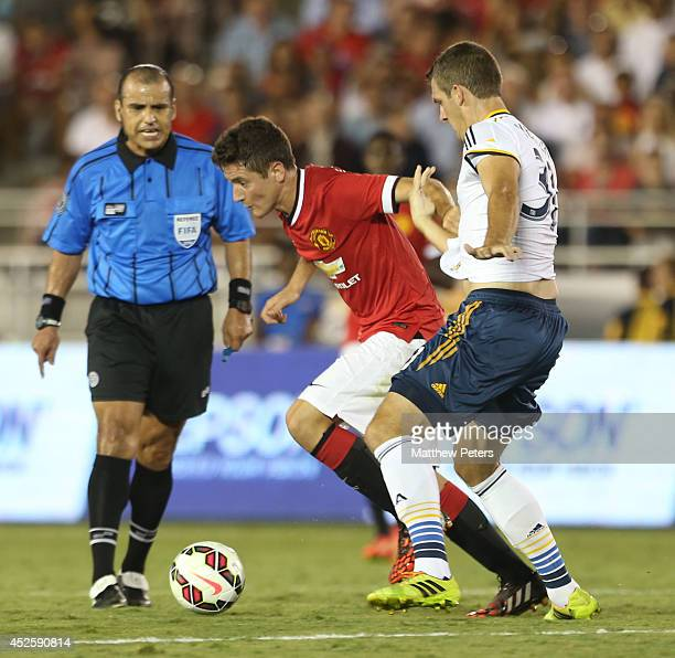 Ander Herrera of Manchester United in action with Chandler Hoffman of Los Angeles Galaxy during the preseason friendly match between LA Galaxy and...